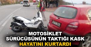 Motosiklet sürücüsünün taktığı kask hayatını kurtardı