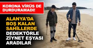 Alanya'da boş kalan sahillerde dedektörle ziynet eşyası aradılar
