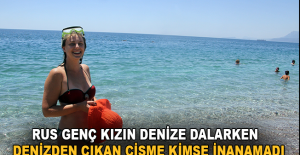 Rus gencin denize dalış yaparken denizden çıkan cisime kimse inanamadı
