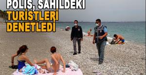 Polis, sahildeki turistlere sıkı denetim uyguladı