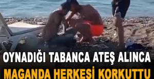 Dünyaca ünlü sahilde oynadığı tabanca ateş alan maganda herkesi korkuttu