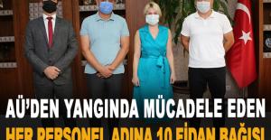 AÜ'den yangında mücadele eden her personel adına 10 fidan bağışı